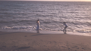 Behind the scenes snapshot of a beach maternity session by Bay Area Portrait photographer TeAirra Mitchell